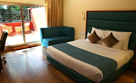 Hotel Cama Veerandah Room with outside sitting area, Spacios rooms best in Mohali, Ranked top in Mohali in TripAdvisor.